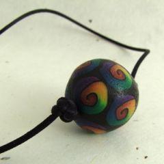 Rainbow spiral on black bead satin cord necklace
