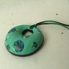 green doughnut pendant