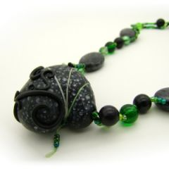 black and green bead necklace with chunky focal