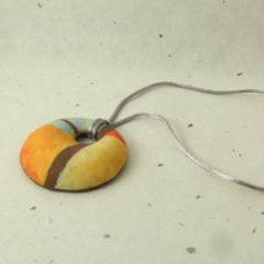 orange brown and grey pendant on satin cord