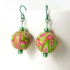 Bright pink and green art bead earrings on emerald green niobium wire