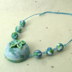 Blue marbled flower pendant on adjustable cord necklace