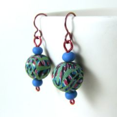Green and aqua bead earrings on pink niobium hooks