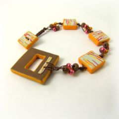 Orange and brown macrame and bead bracelet