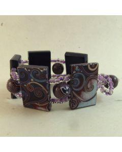 Spiral panel ladder bracelet
