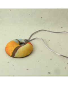 orange brown and grey pendant on satin cord