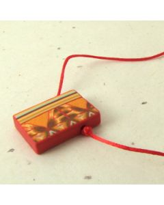 red orange and brown geometric pattern pendant