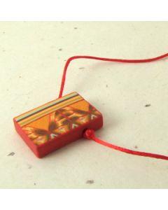 red orange and brown geometric pattern pendant