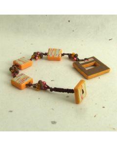 Orange and brown macrame and bead bracelet