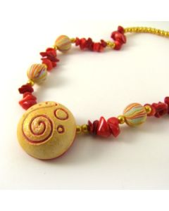 Red and orange necklace with art beads and coral