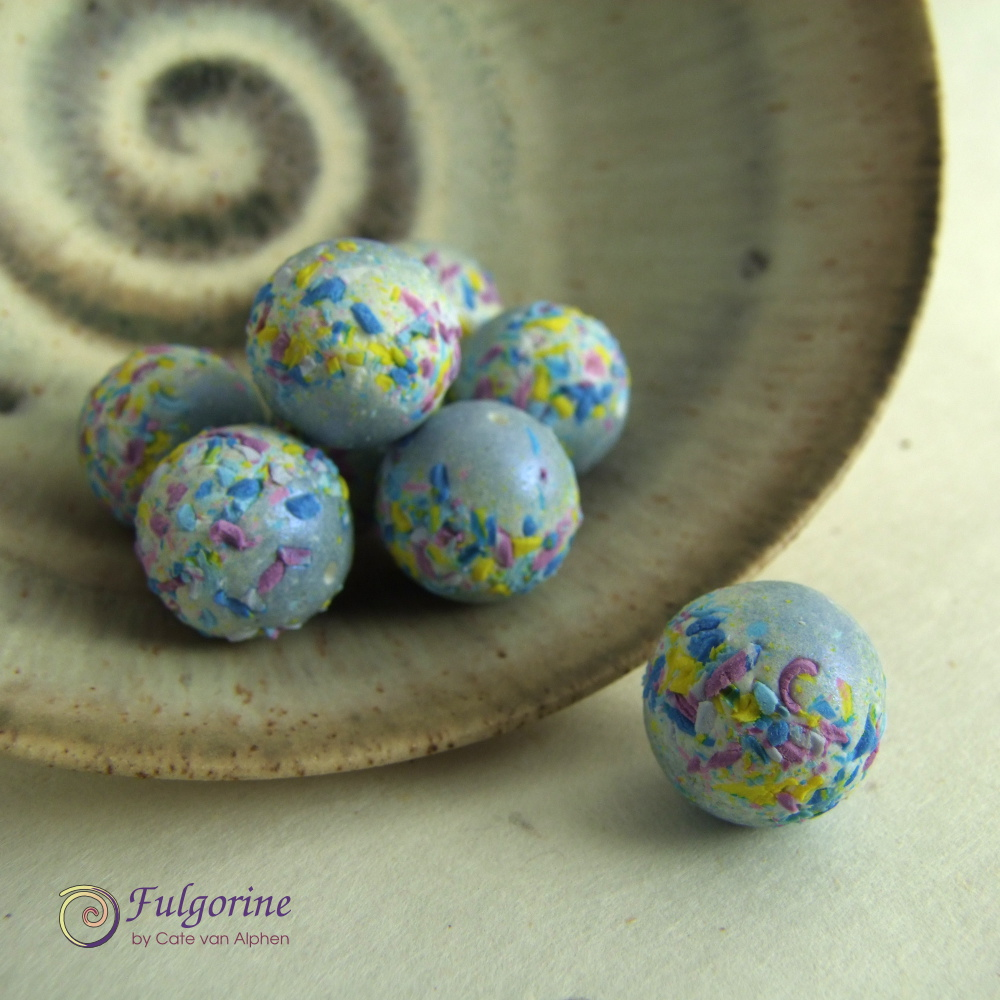 Blue beads with scraps as decoration